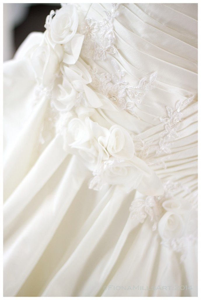 delicate flower detailing on the wedding dress