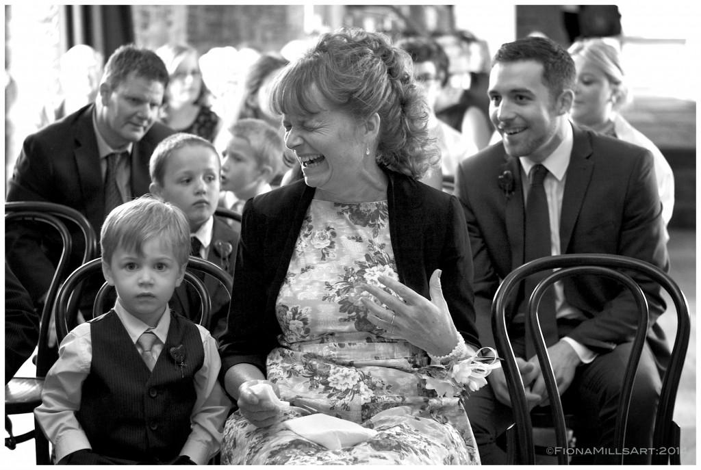 Something has tickled Paul's Mum!